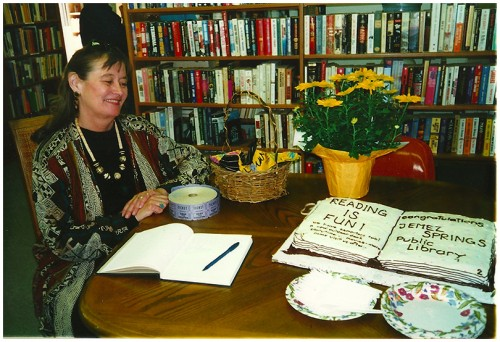Alice Rodgers, Friends of the Library member, greeted visitors and later cut the cake.