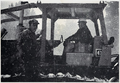 Left-Cliff Hofheins, President of CJC Inc.; right-Rex Bond, machine operator, and one of the company's D6C crawler tractors, at work on a very snowy day in the Jemez Mountains.