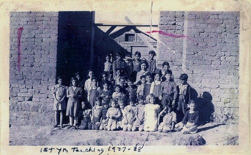Dora C' De Baca Romero and students in her first year of teaching at Cañon School in 1937. Picture was taken in front of WPA school that her father, Manuel C' De Baca as building.